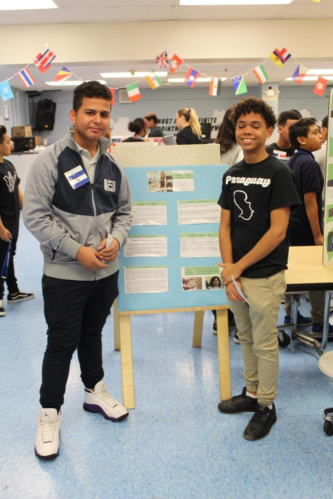 two boys with their research presentation