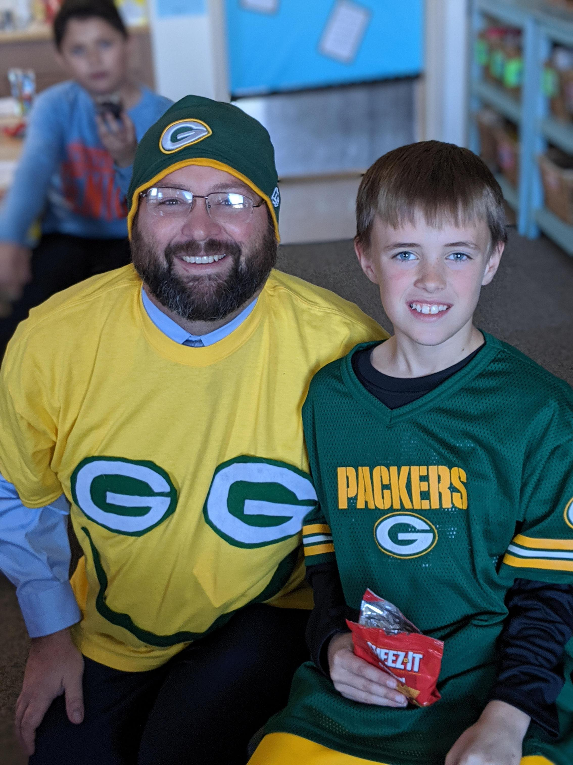 Mr. Bowe and Student Showing Packer Pride