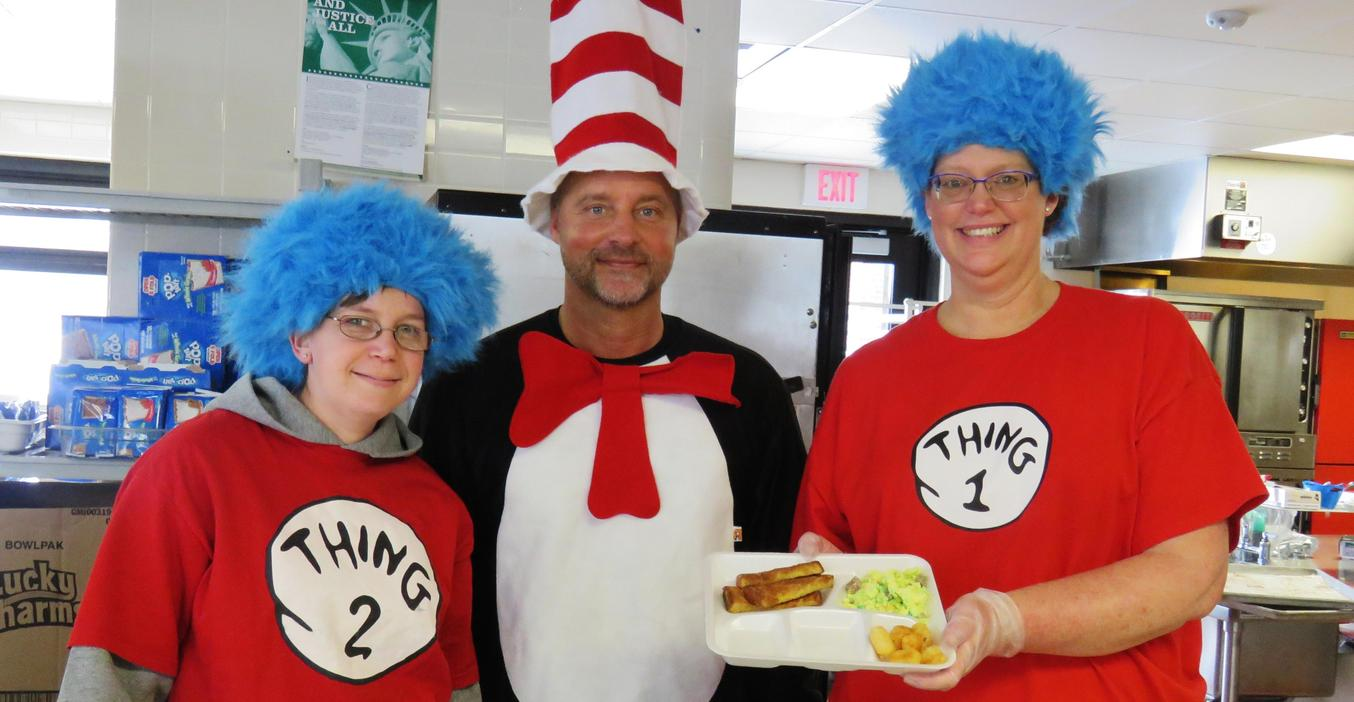 McFall Principal Jon Washburn and cafeteria employees serve up green eggs and ham.