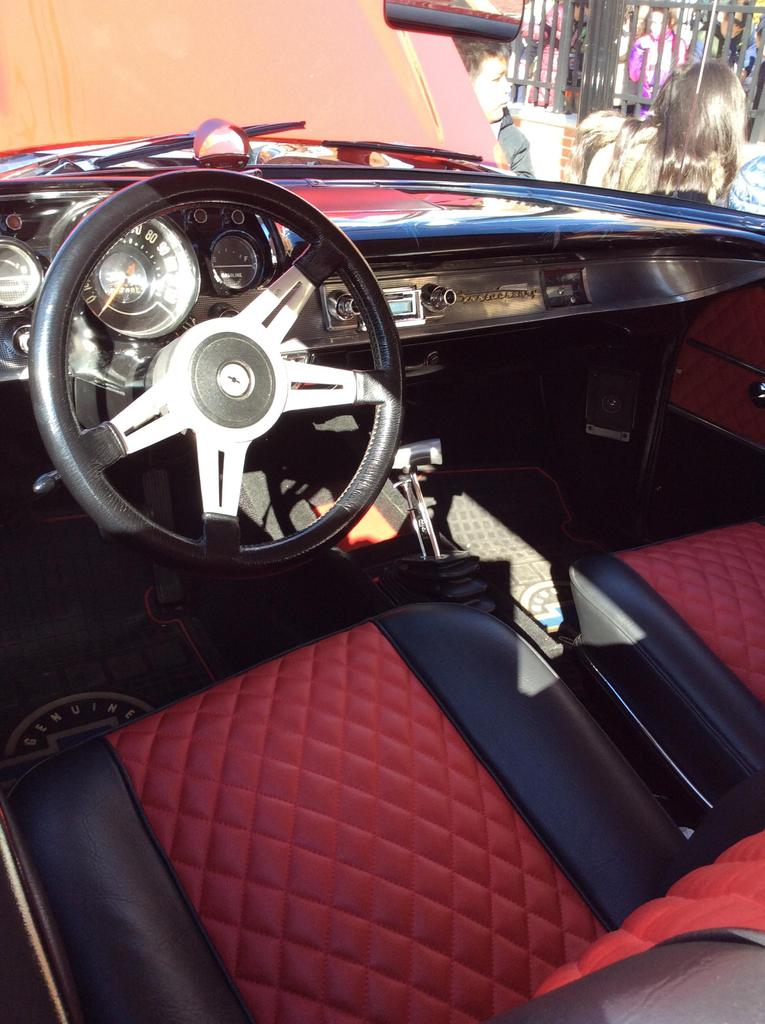 close up of the steering wheel and dashboard of the 57 Chevy