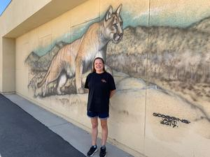Laura Hafner in front of the Cottonwood lion cat.