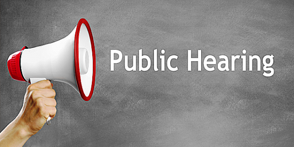 Megaphone announcing Public Hearing