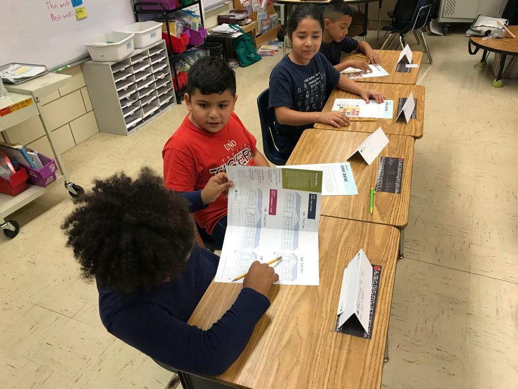 3rd grade works on their junior achievement packet