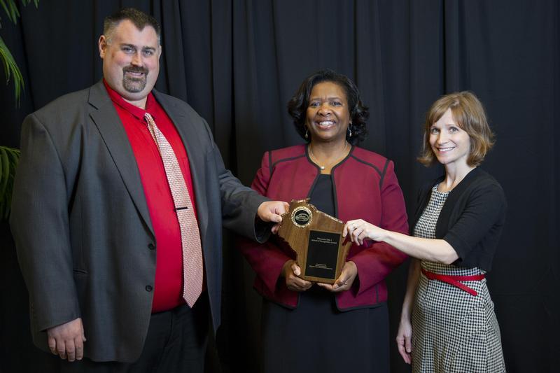 Tenor staff accepting award