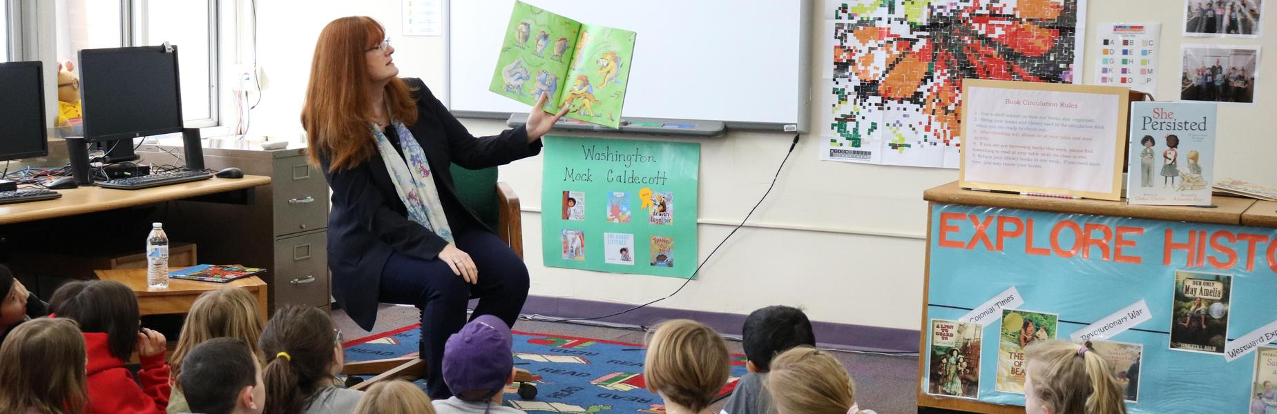 Photo of Westfield Public Schools Superintendent Dr. Margaret Dolan reading to 2nd graders at Washington School during Read Across America activities.