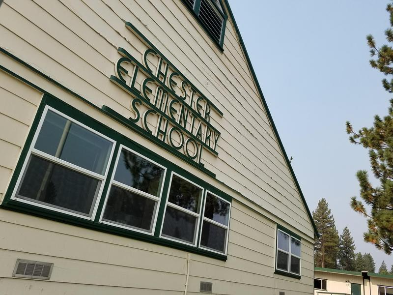 Front of Chester Elementary School, showing white building with school name in green