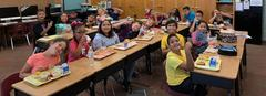 Mrs. McMillan's class enjoys lunch together.