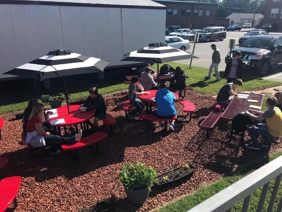 Student at Davidson County High School enjoying learning outside at the school's new outdoor tables and umbrellas