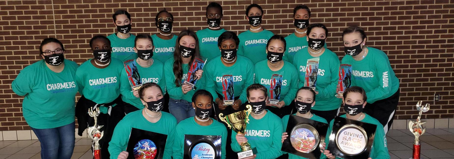 group of girls in matching charmers t-shirts holding awards