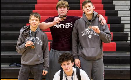 picture of boys with wrestling medals