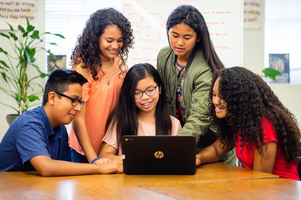 Students around laptop