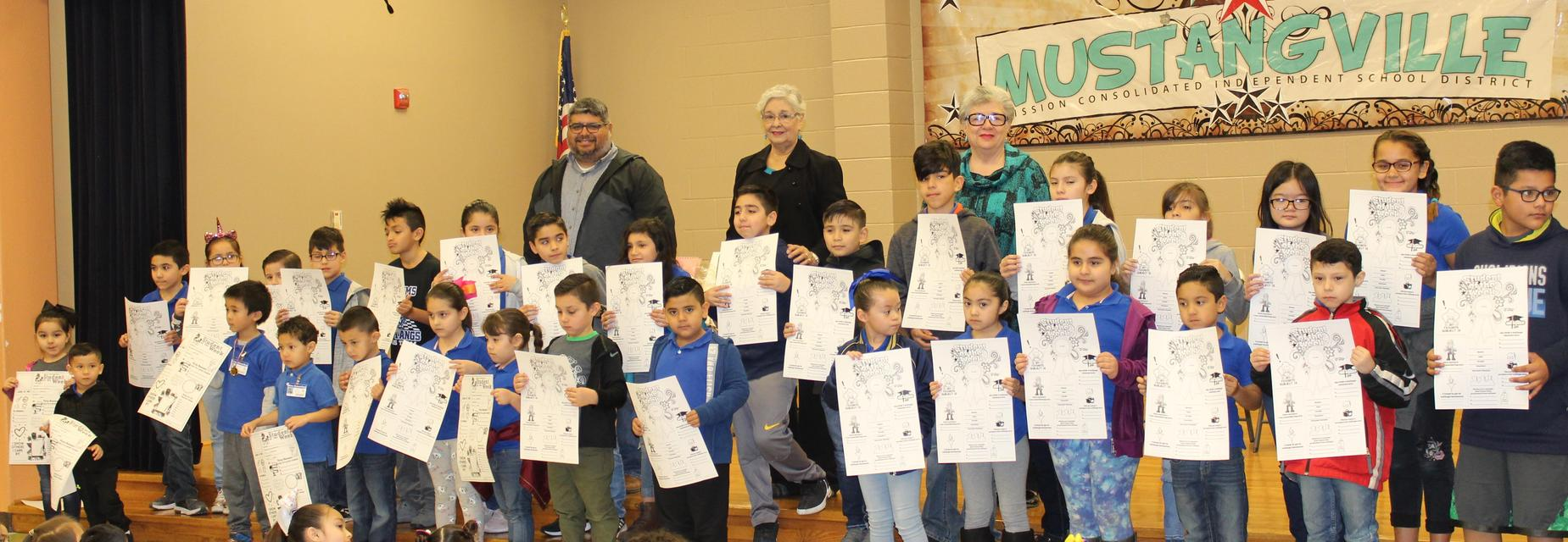 students with Student of the week posters and school board members