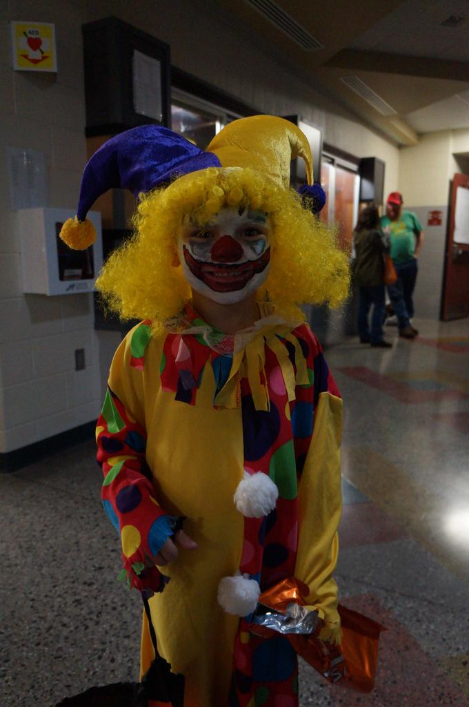 Student in clown Halloween costume at Spooktacular event