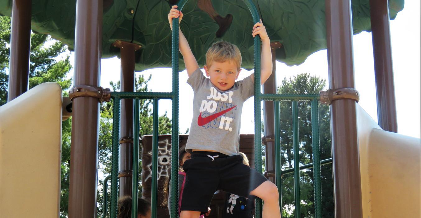 A McFall boy plays on the playground.
