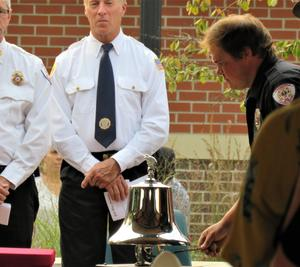 Members of the Thornapple Township Emergency Services tolled the bell the Five Fours in honor of emergency workers who lost their lives.