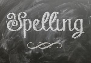 chalkboard with the word spelling written on it