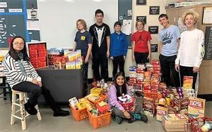 The Edison Student Government Association held a Thanksgiving food drive with 200+ items collected and donated to area food banks and shelters.  Members are pictured here with collected food items.