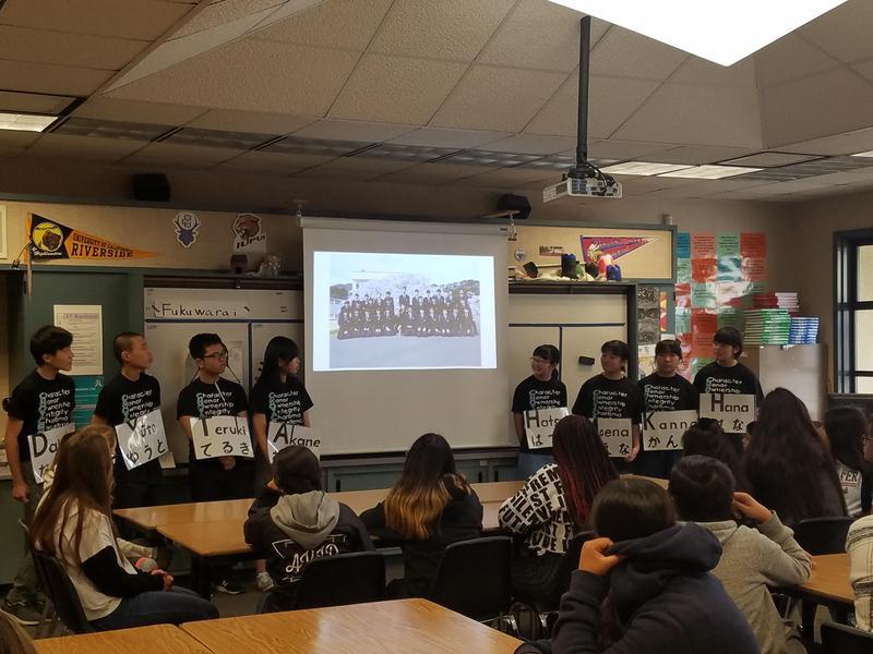 Japanese students from Marumori, Japan, giving a presentation to Dartmouth AVID students.