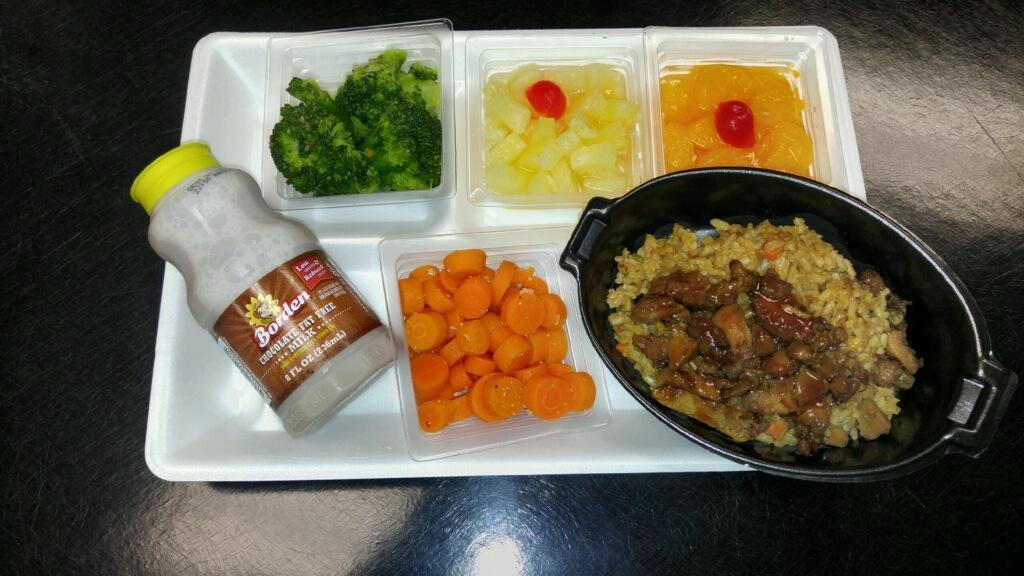 rice bowl with veggies fruit and milk