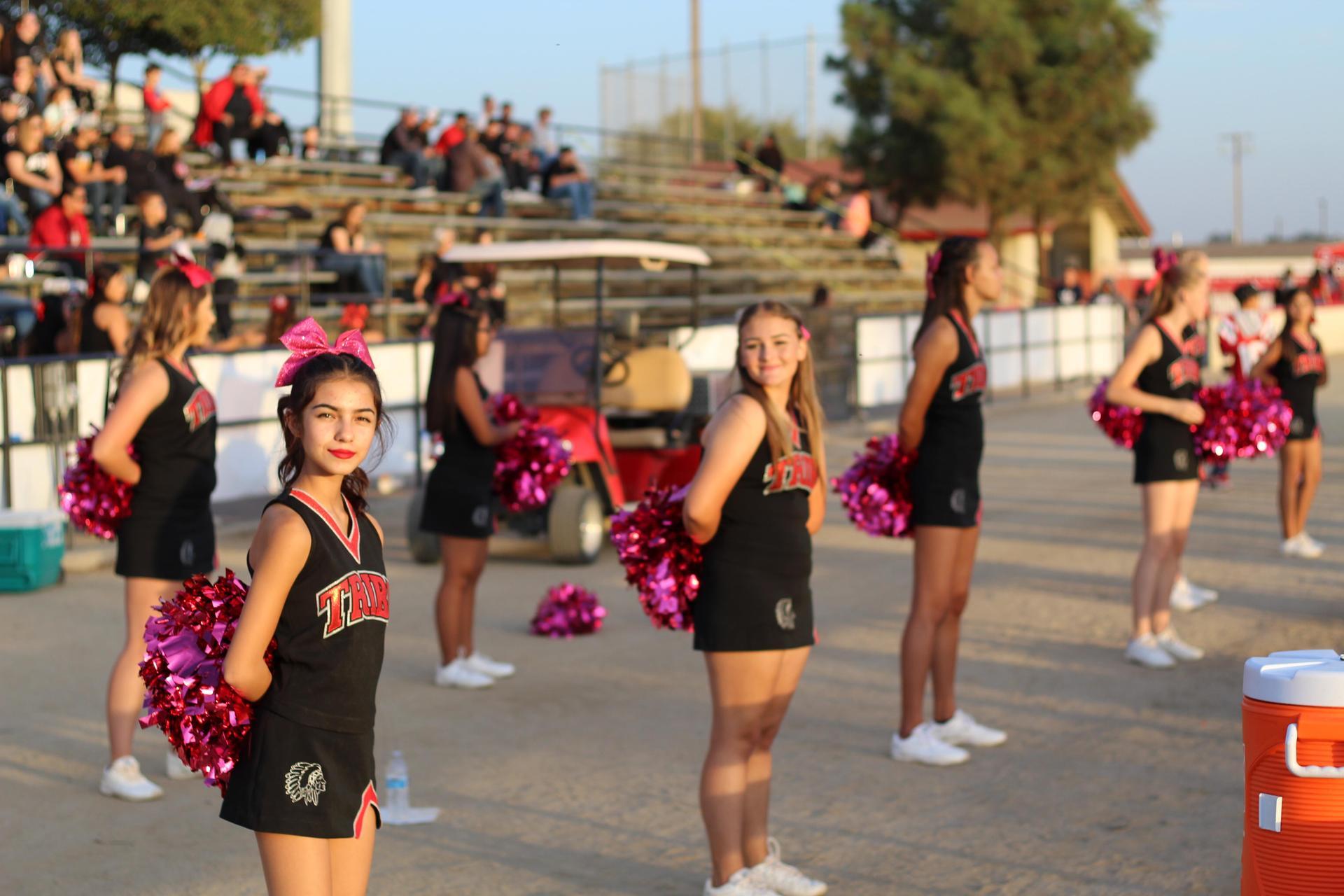 Tribe Cheerleaders Watching the Football Game