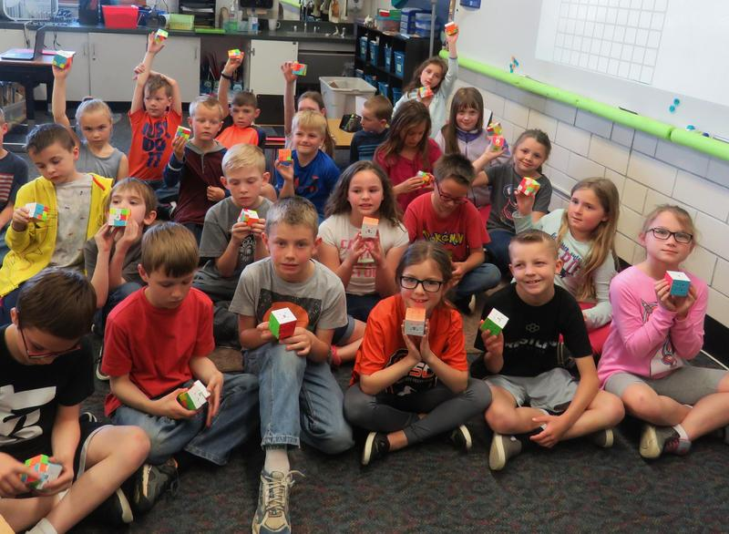 Mr. Barnes' second-grade students work on their Rubik's Cube puzzles.