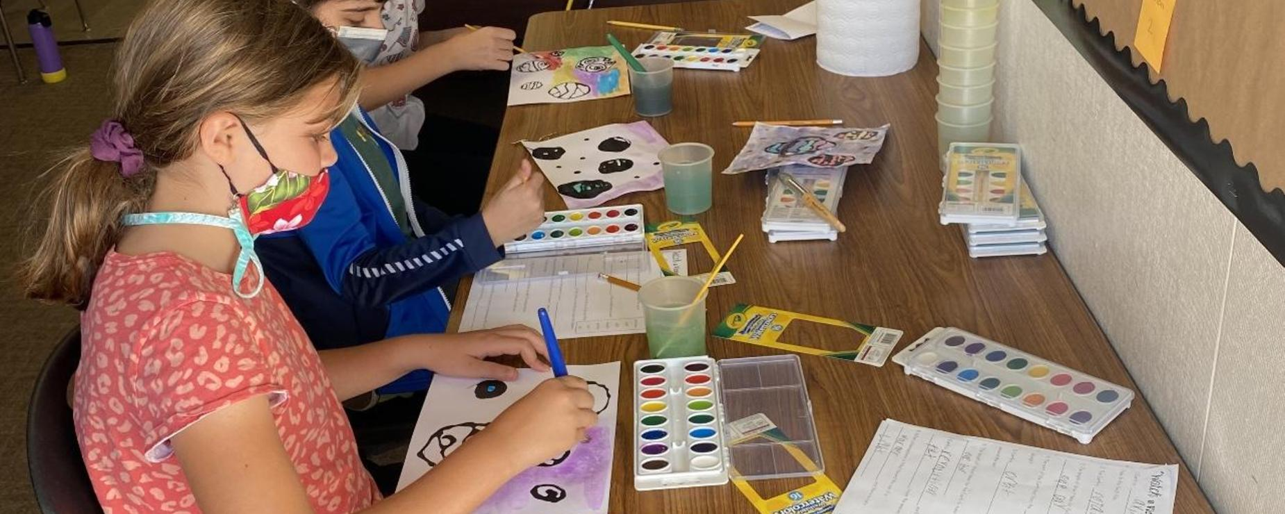 Students painting the planets