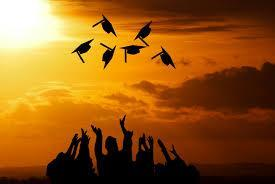 picture of graduation caps thrown in air