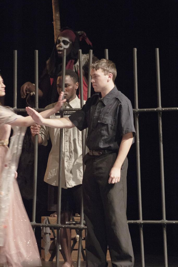 The Gatekeeper, played by Carl Dunham, extends his right arm and palm