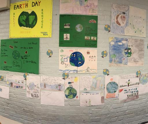 Earth Day Posters mounted on wall.