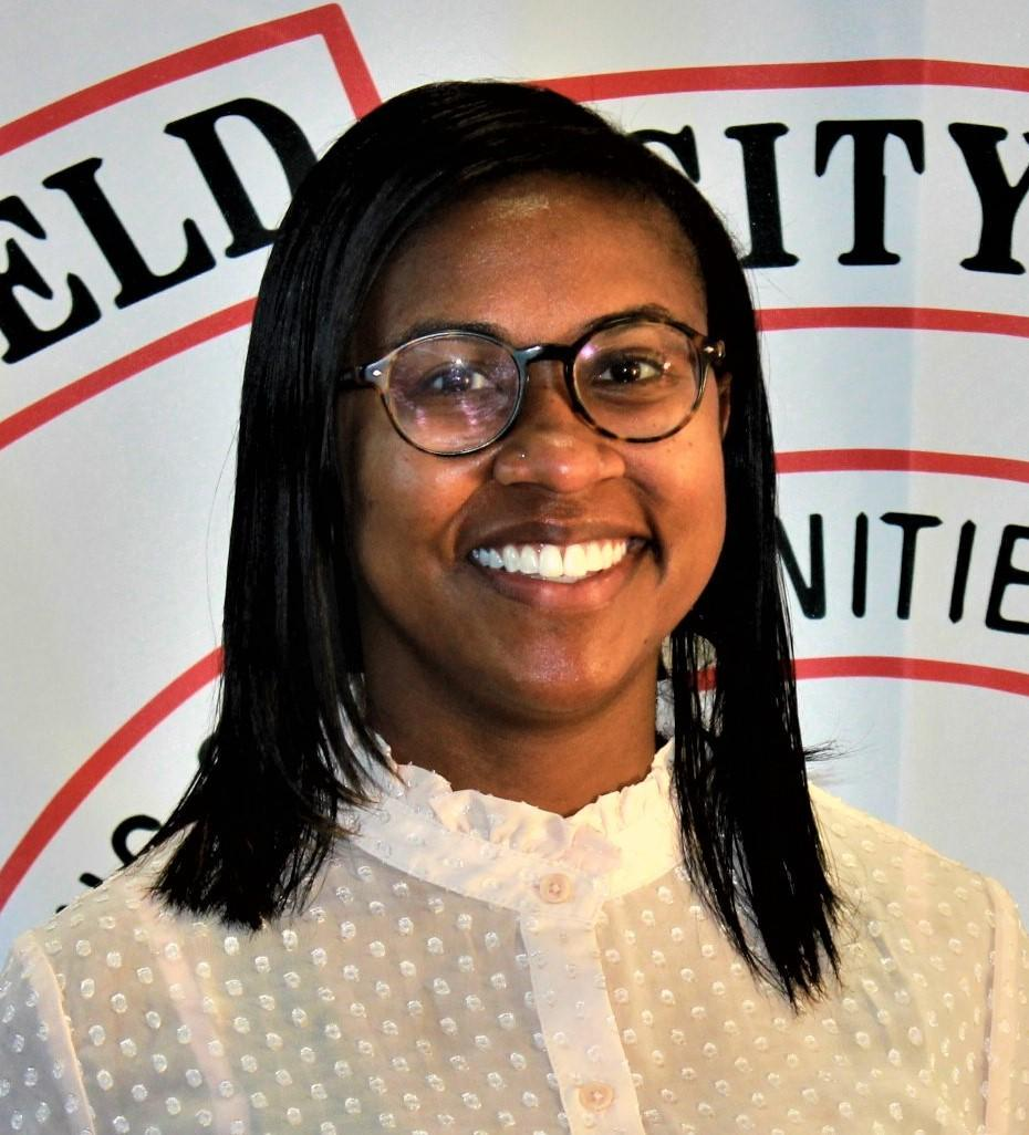Photo of Britni Tudor the new assistant principal at West Elementary. She is African American, has shoulder length black hair and wears glasses.
