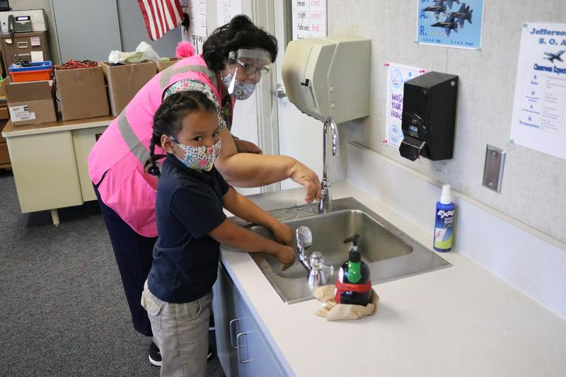 Student being trained on proper hand washing techniques.