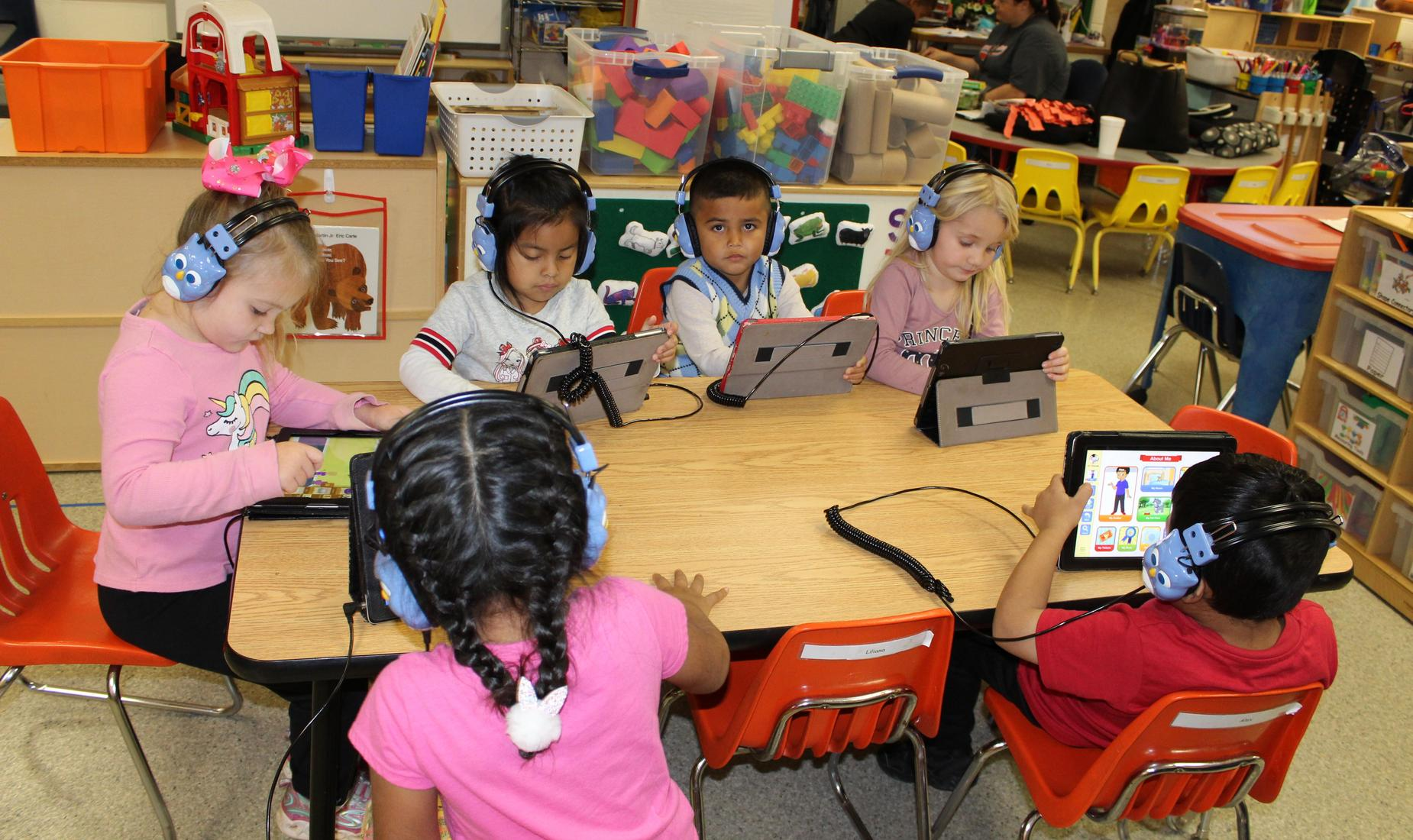 PreK students working on ipads