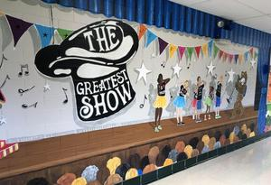 One of the scenes in a mural at Jefferson School where 2nd and 3rd graders recently joined parent volunteers in transforming school hallways into a magical scene of the many events that take place each year.