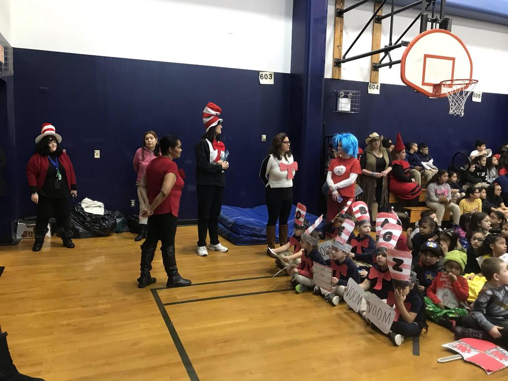 teachers dressed as favorite characters in the gym
