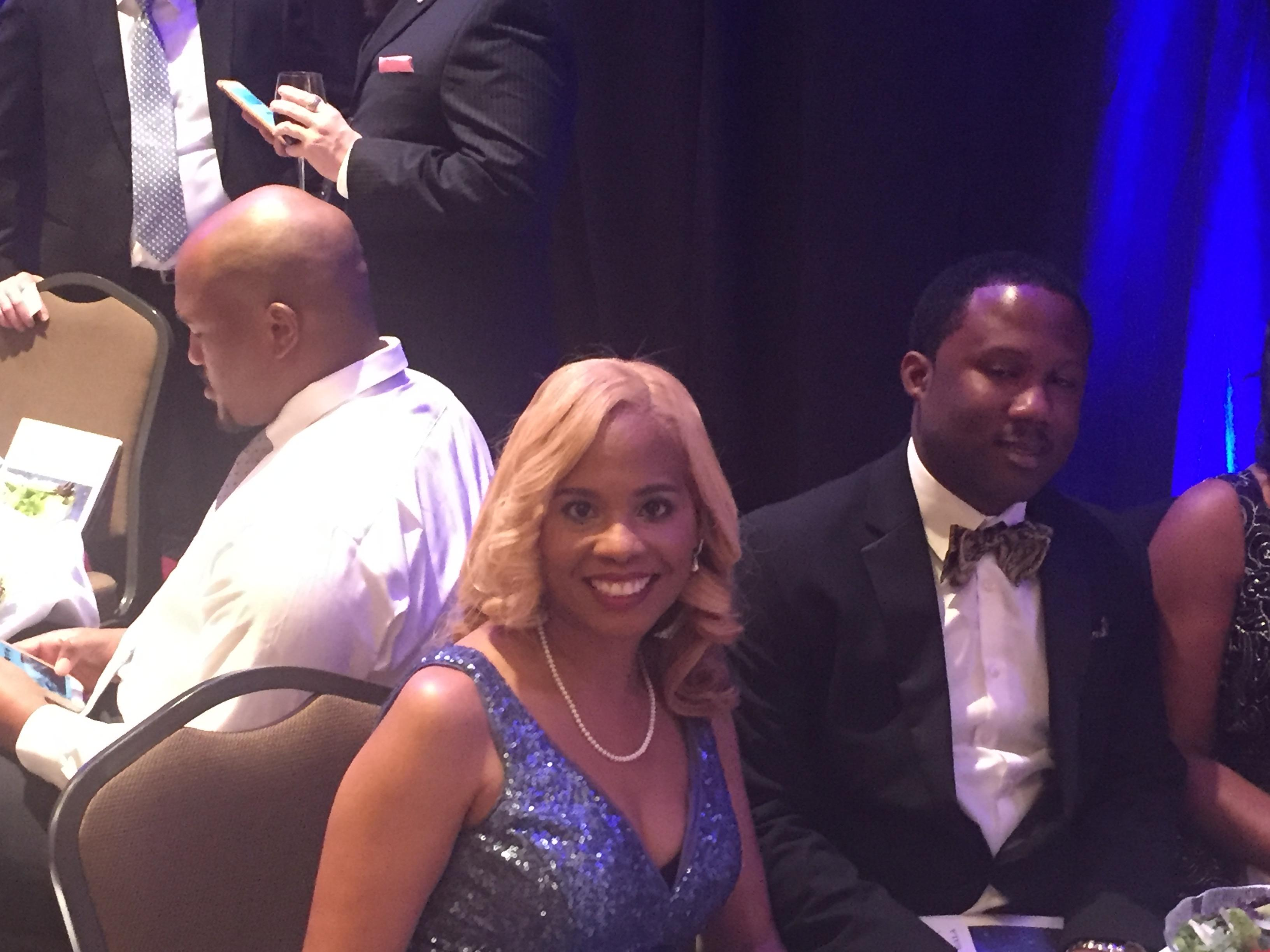 Photo of Principal Penn sitting next to her brother-in-law at the gala honoring educators from across the state