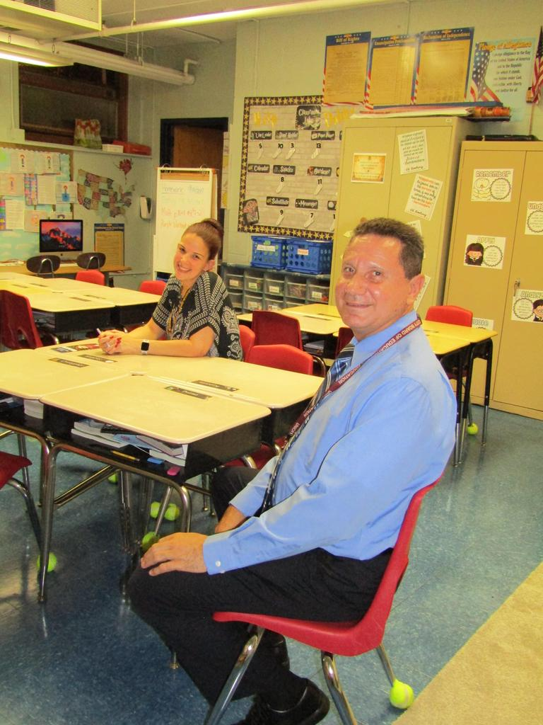 teacher and aide eagerly awaiting parents