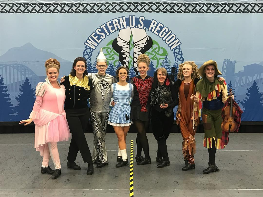 Dancers dressed as Glinda the Good Witch, the Wizard of Oz, the Tin Man, Dorothy, The Wicked Witch, Toto, the Cowardly Lion, and the Scarecrow from Wizard of Oz