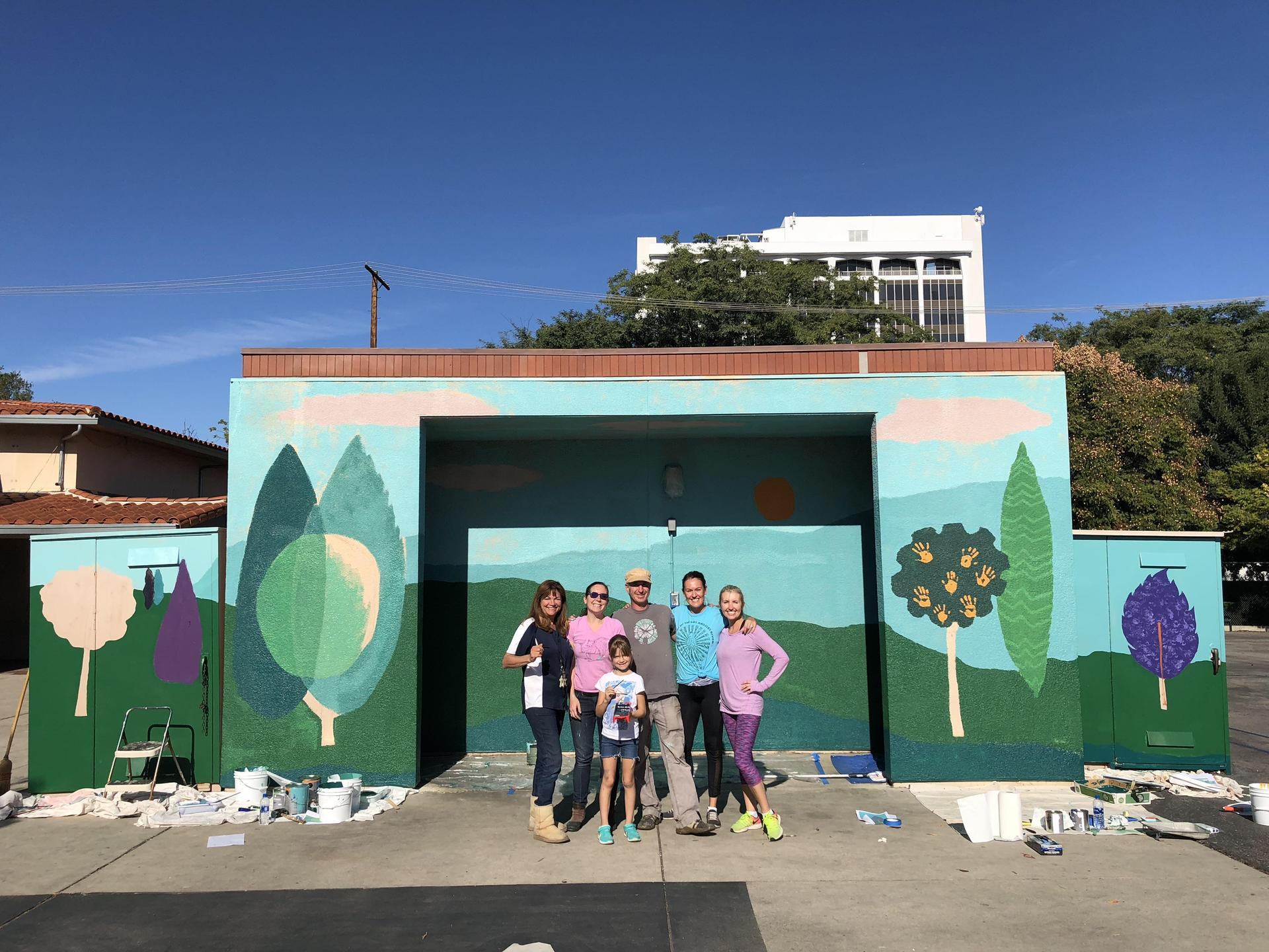 Mural and volunteers