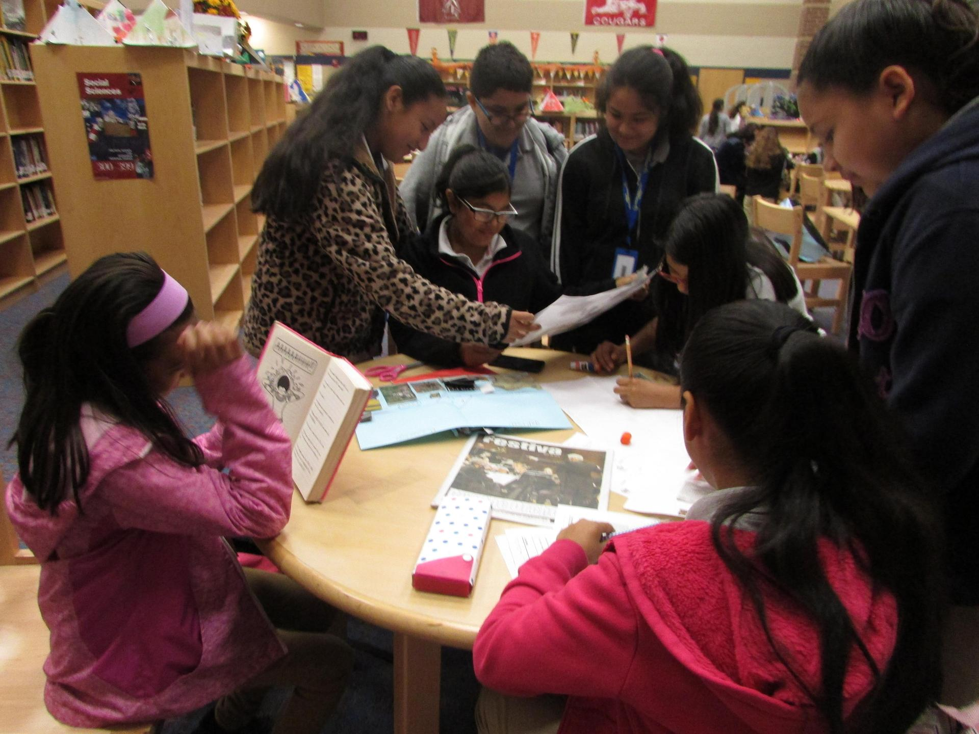 Students working on social studies project at the library.