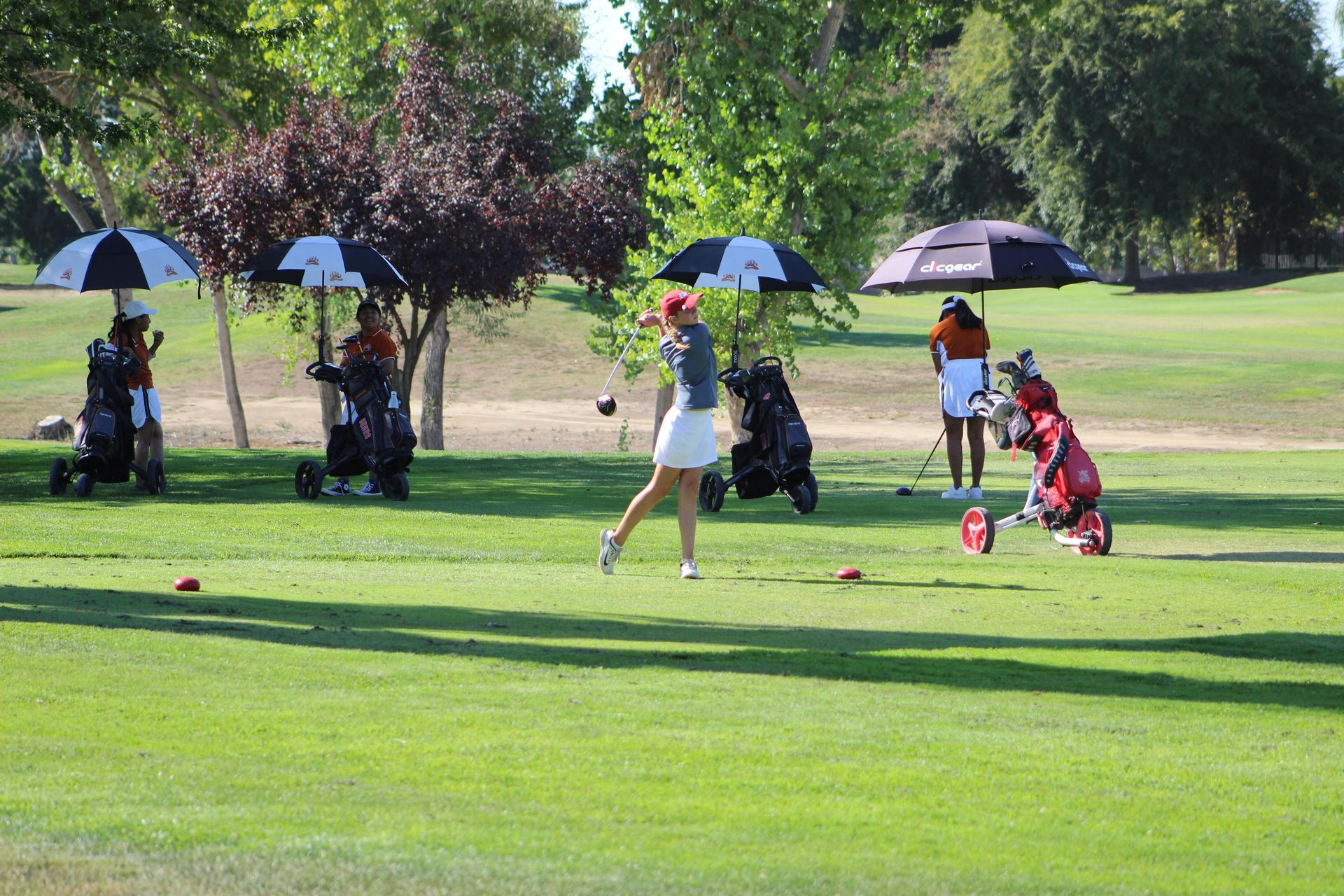 girls playing golf against Selma