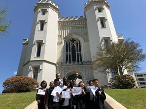 A photo of the PRAMS student and faculty team participating in the 2019 Youth Legislature. The are standing in front of the Louisiana Old State Capital