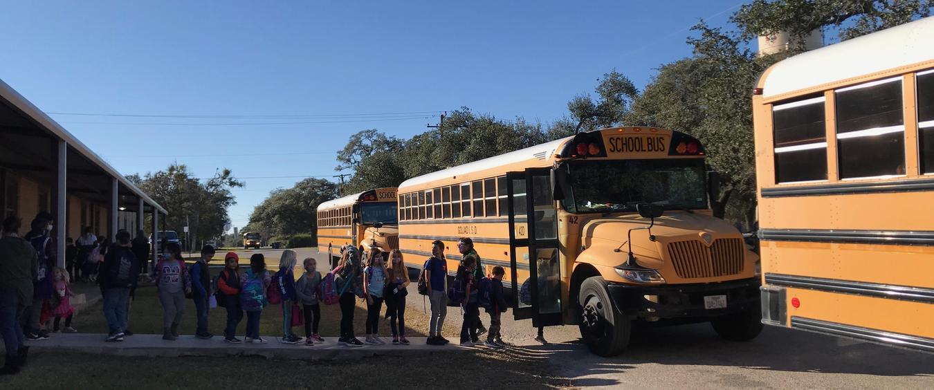 Kids loading on school bus