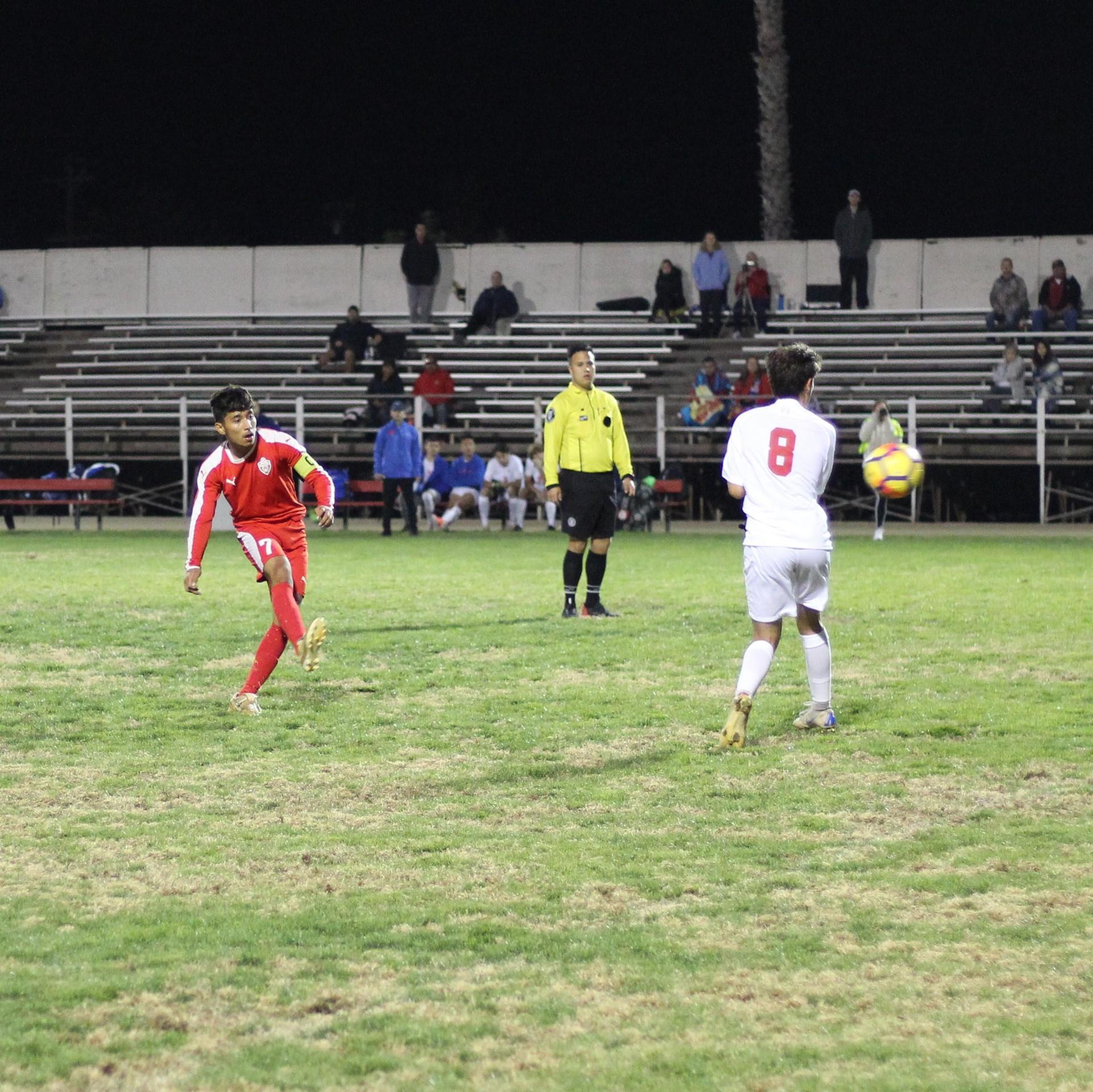 Luis Reyes kicking the ball