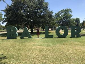 Pictured is Isla Coronado with the famous Baylor sign during the camp.