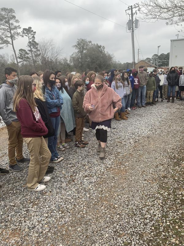 8th Grade Students gather to honor classmate's passing.