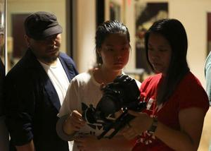 Film school staff reviewing footage from the shoot.