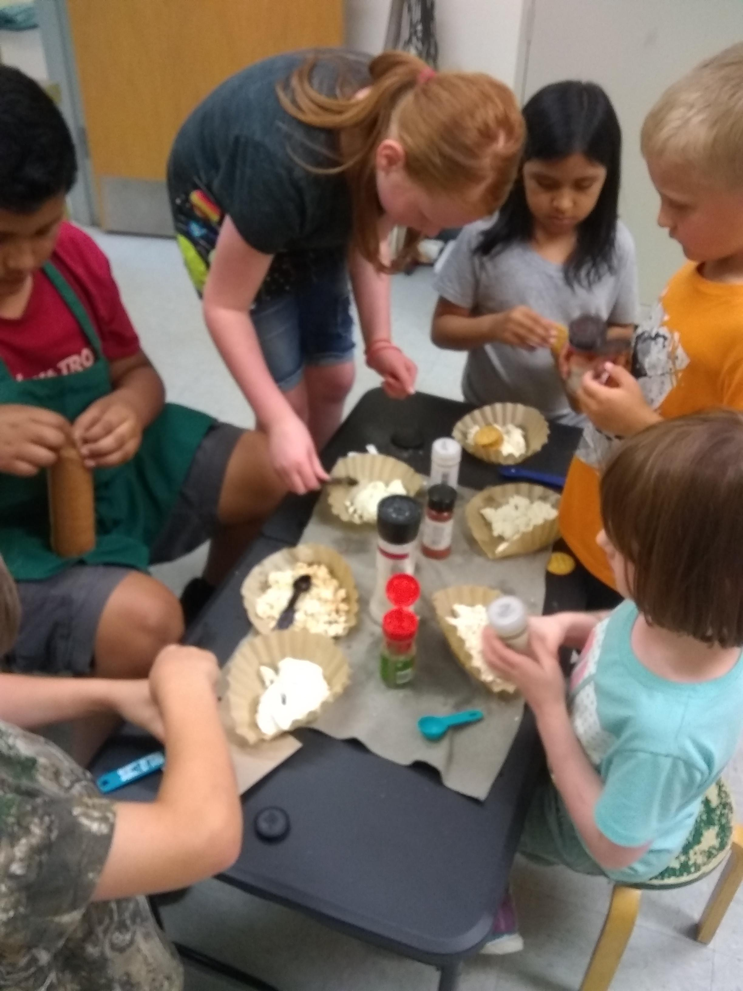 students adding spices to their cheese