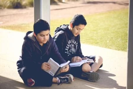 Two students reading books.