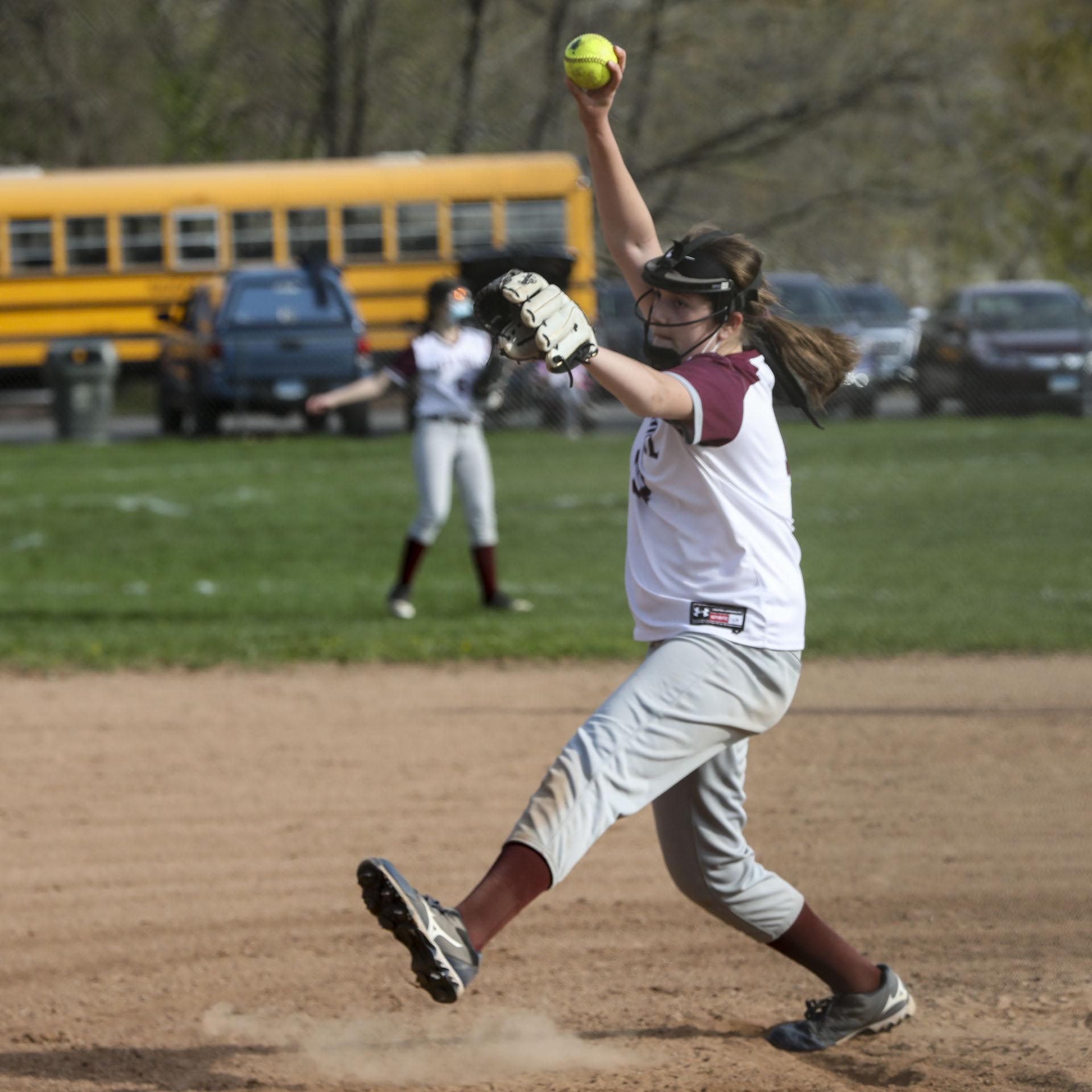 Softball player pitching the ball