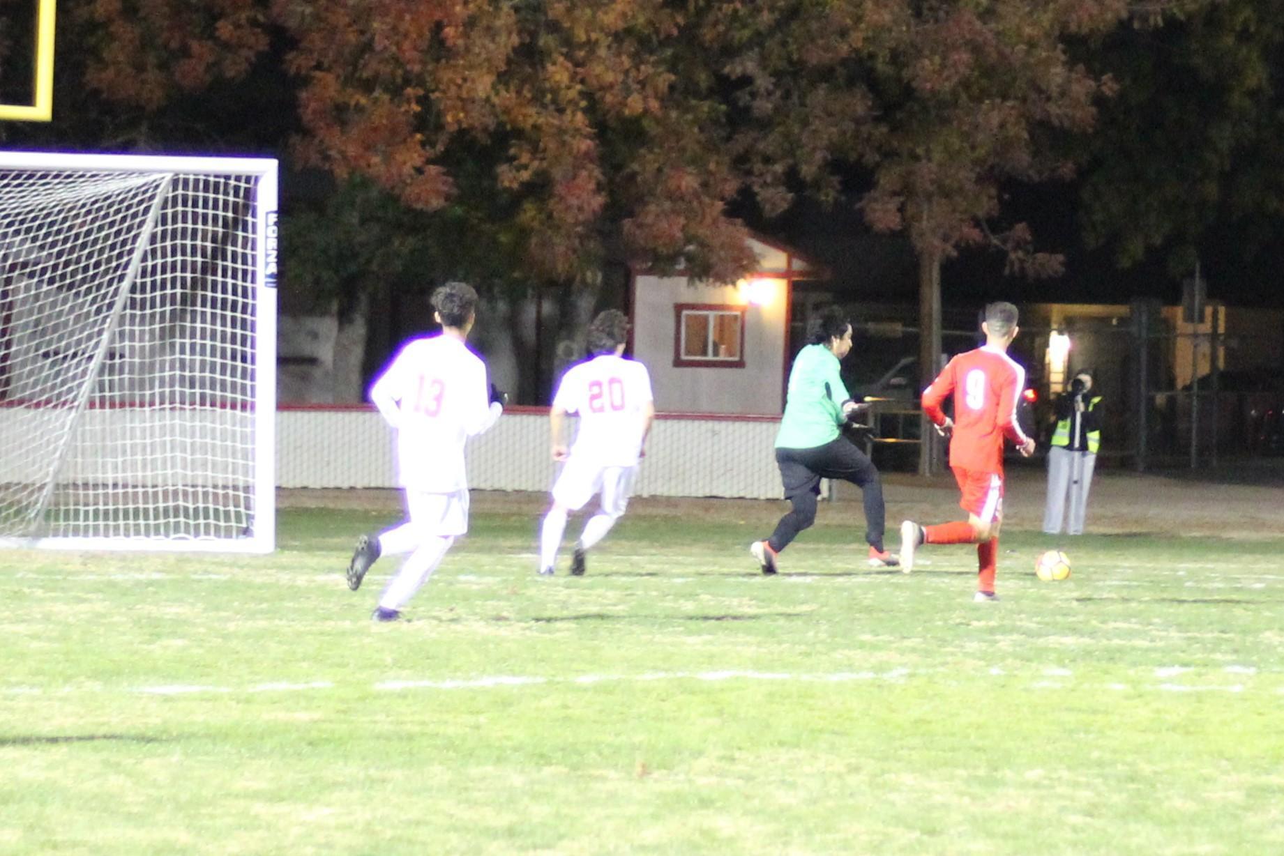Jose Renteria running to the ball